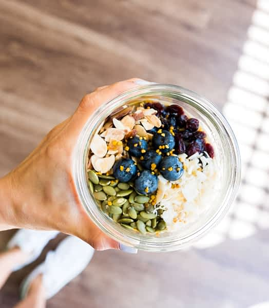 A mix of nourishing ingredients served in a glass jar.