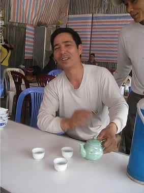 Tuan enjoys peace shared over tea.