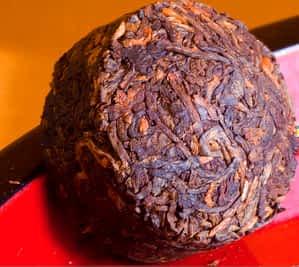A Golden Mini Pu-erh Toucha (Cake Tea)