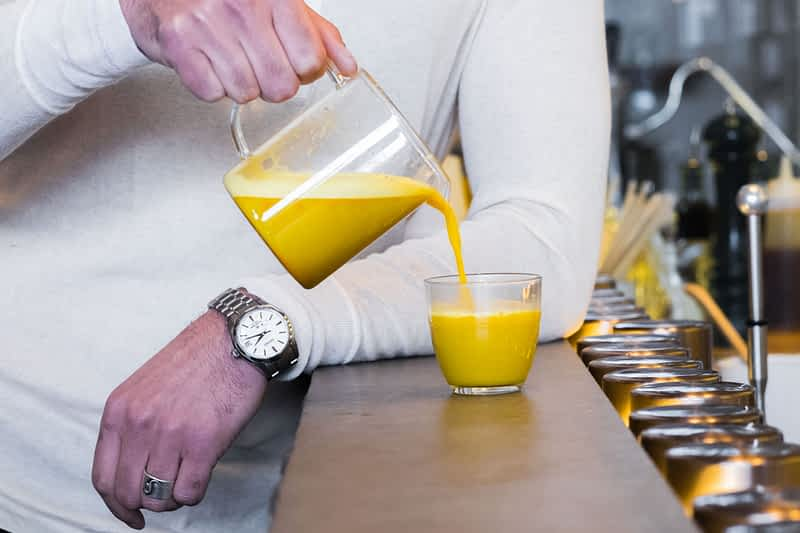 Organic Turmeric Golden Milk in Vivid Brew Pouring